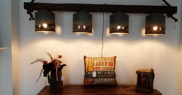 Light fixture, table and decorations at Antique Barnwood Creations in New Philadelphia