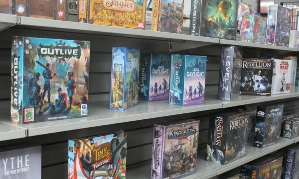 Board games on shelves at Mad Bros